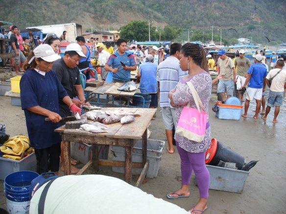 Striking a deal on a fish, Puerto Lopez